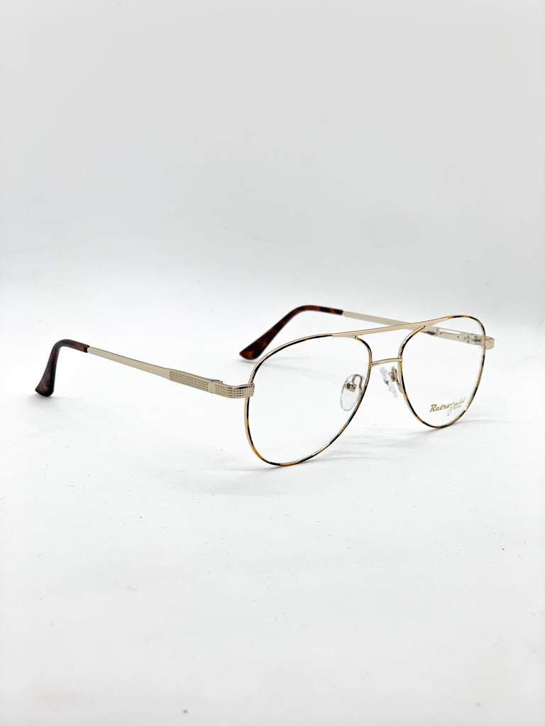 Gold and tartoise retro glasses fom a side