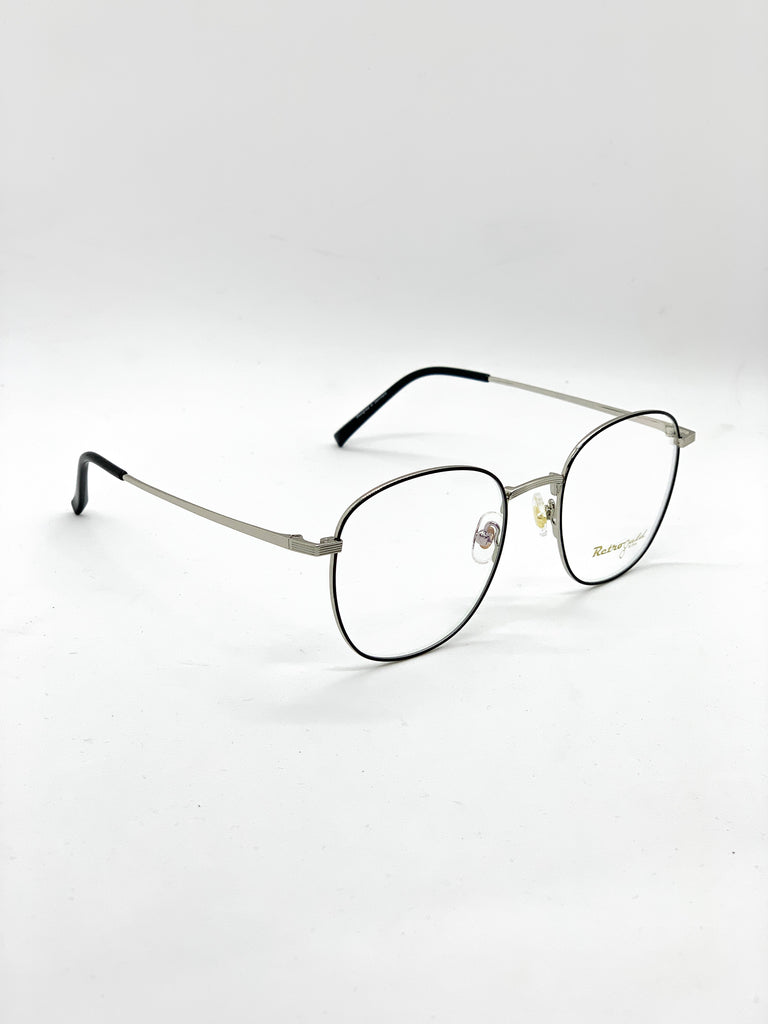 Silver and black retro glasses fom a side