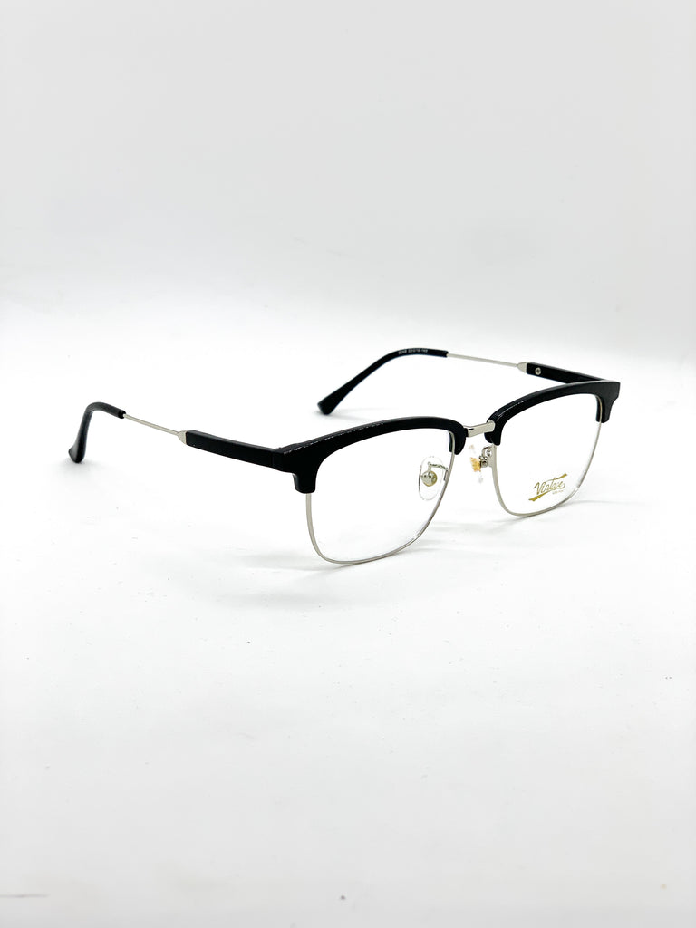 Silver retro glasses fom a side