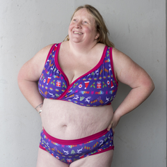 Model is wearing a purple Christmas print underwear set.