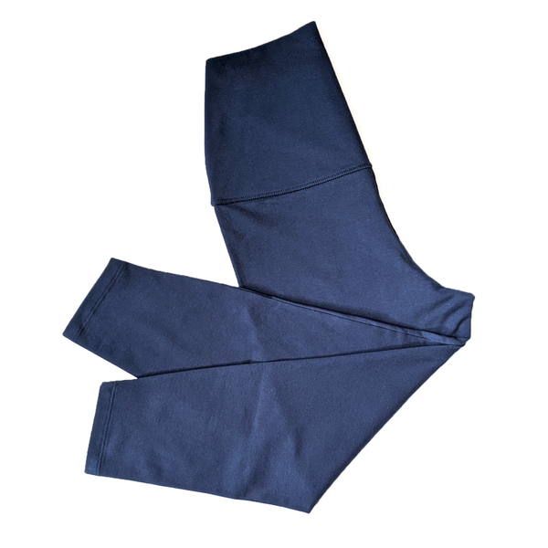 Flatlay image of a folded pair of Navy leggings.