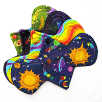 Flatlay of Night absorbency CSP in Dinos, Universe, Wavy Rainbows and Space fabrics.