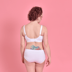 Jenni is wearing a white cotton Flexi size bra and briefsshowing adjustable back and straps