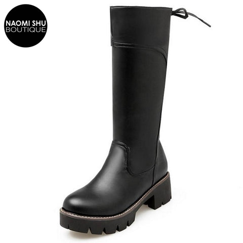 MUDITA Sleek Heeled Shearling Boot