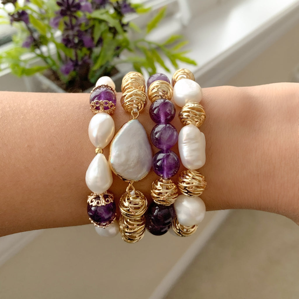 Simra shiny gold swirl and lustrous central white pearl bracelet - The Jewelry Palette