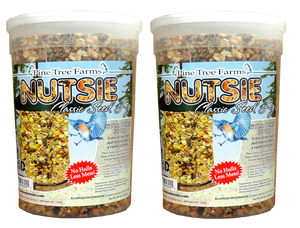 two pack of nutsie seed logs with fruit and nuts