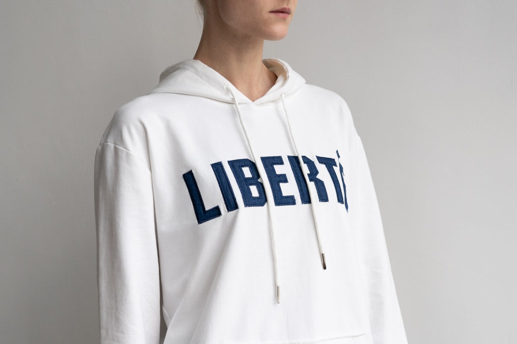 Liberté Unisex Pullover Hoodie in White