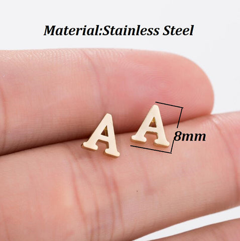 Here's a question; how do you spell 'Cute'? With four pairs of these cheerful Alphabet Stud Earrings, that's how!  Well.. maybe that and a trip to the local Body Piercing expert! No matter how many Spelling-Bee's you have won (or haven't entered), it's easy to sound-out the savings when you check out our sale-price.  Keeping up a fresh look can be an expensive way of life after all!   We use surgical stainless steel as the base metal in these simple, classic studs - perfect for wearing in the summer months or in hotter climates - and then painstakingly plate them in your desired finish (Gold, Silver or Cobalt) to make sure the end result is smooth and detailed (even in those teeny little corners!), before shipping them out to you. That's why we don't just think you'll love them. We know you'll love them! Just like all the amazing custom-personalized or artisan hand-crafted treasures in the CustomizedBling.net Catalog, these C-U-T-E Statement Studs are protected by our easy 30 day return policy; and feature complete package tracking from origin to destination at No Charge under our standard shipping rates!        Base Metal: Stainless Steel construction (benefits include: Sturdy and long lasting jewelry, jewelry can be worn in hot and cold climates and the hot summer sun without absorbing heat). Earring Size: Approximately 8 millimeters.