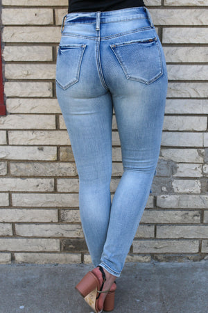Knee Distressed Mid Rise Skinny