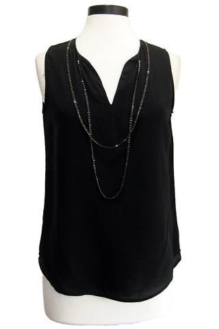 ecru sleeveless top with chain