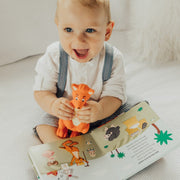 Mizzie The Kangaroo Gift Set with sound book and teething toy boy holding mizzie and book