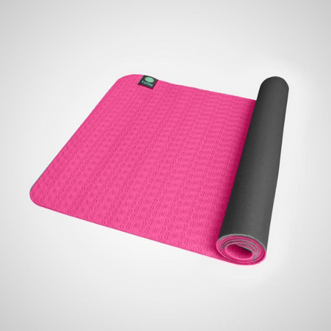 photo of pink yoga mat half rolled