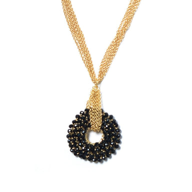 O shape black crystal pendant with crocheted gold chain.