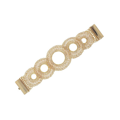 gold bracelet laying flat with large circles with small beaded crystal details