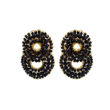 pair of small double hoop earrings made of gold crochet wire and rows of black crystal beads