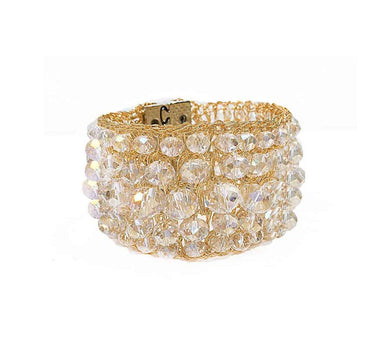 close up of crystal bracelet in gold crochet mesh