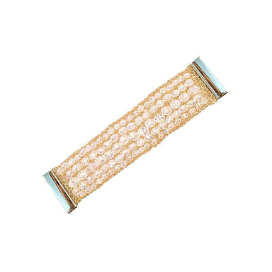 thick bracelet laying flat featuring horizontal rows of crystals and woven gold wire mesh
