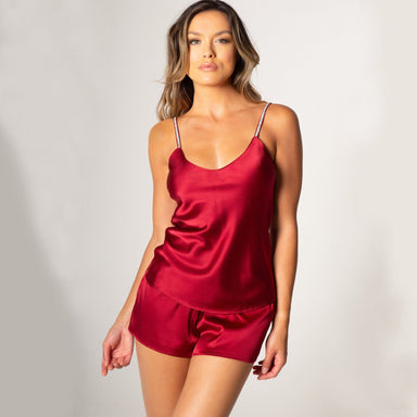 woman wearing red satin camisole and shorts
