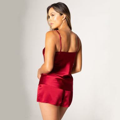 rear view woman wearing red satin camisole and shorts