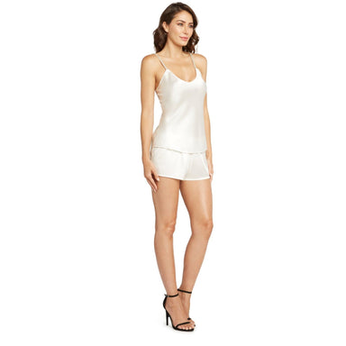 woman wearing white satin camisole and shorts with black heels
