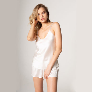 woman wearing white satin camisole and shorts