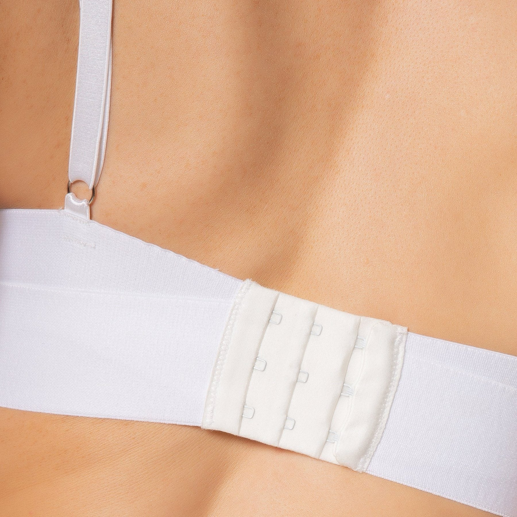 closeup of white bra strap and clasp