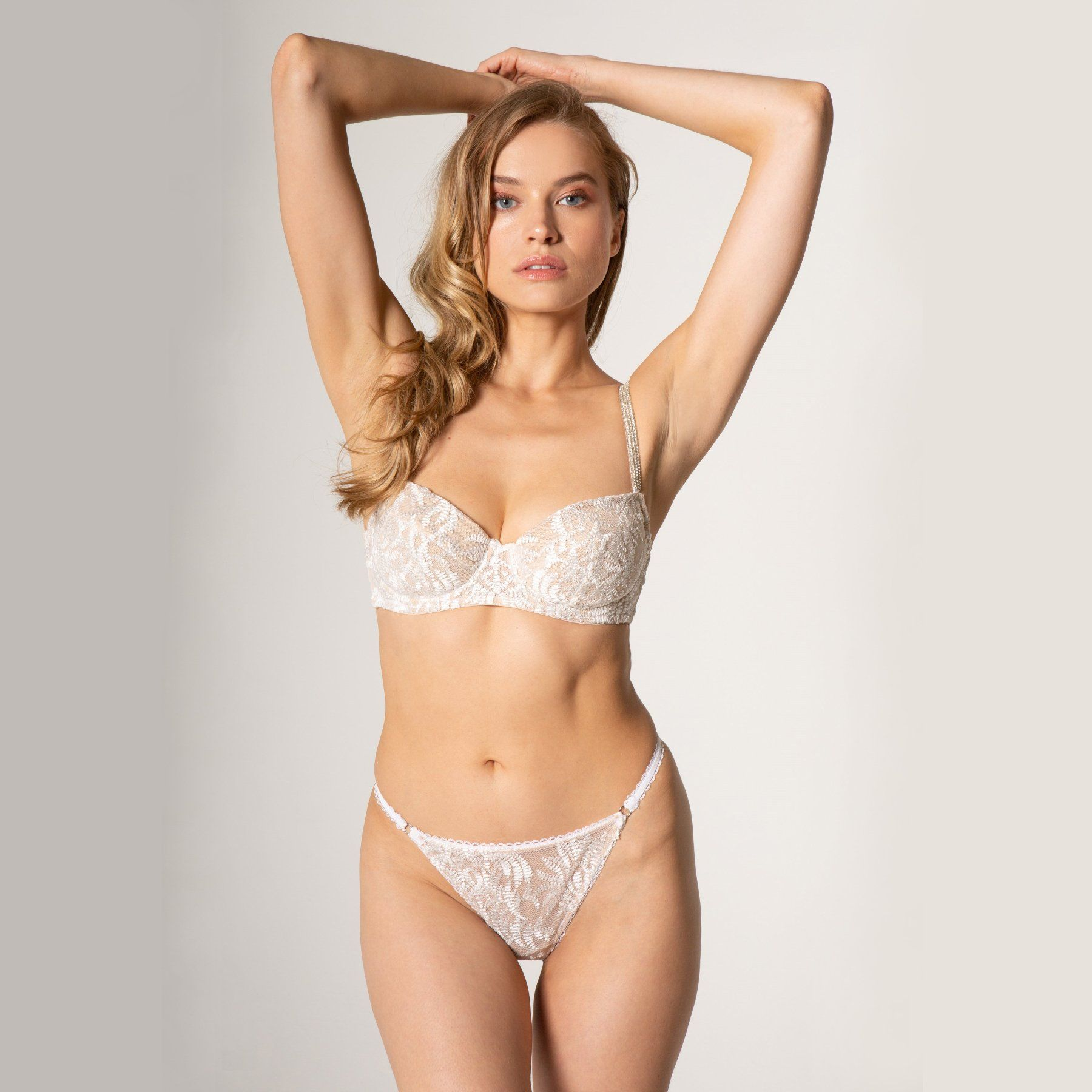 woman wearing white lace bra and panty