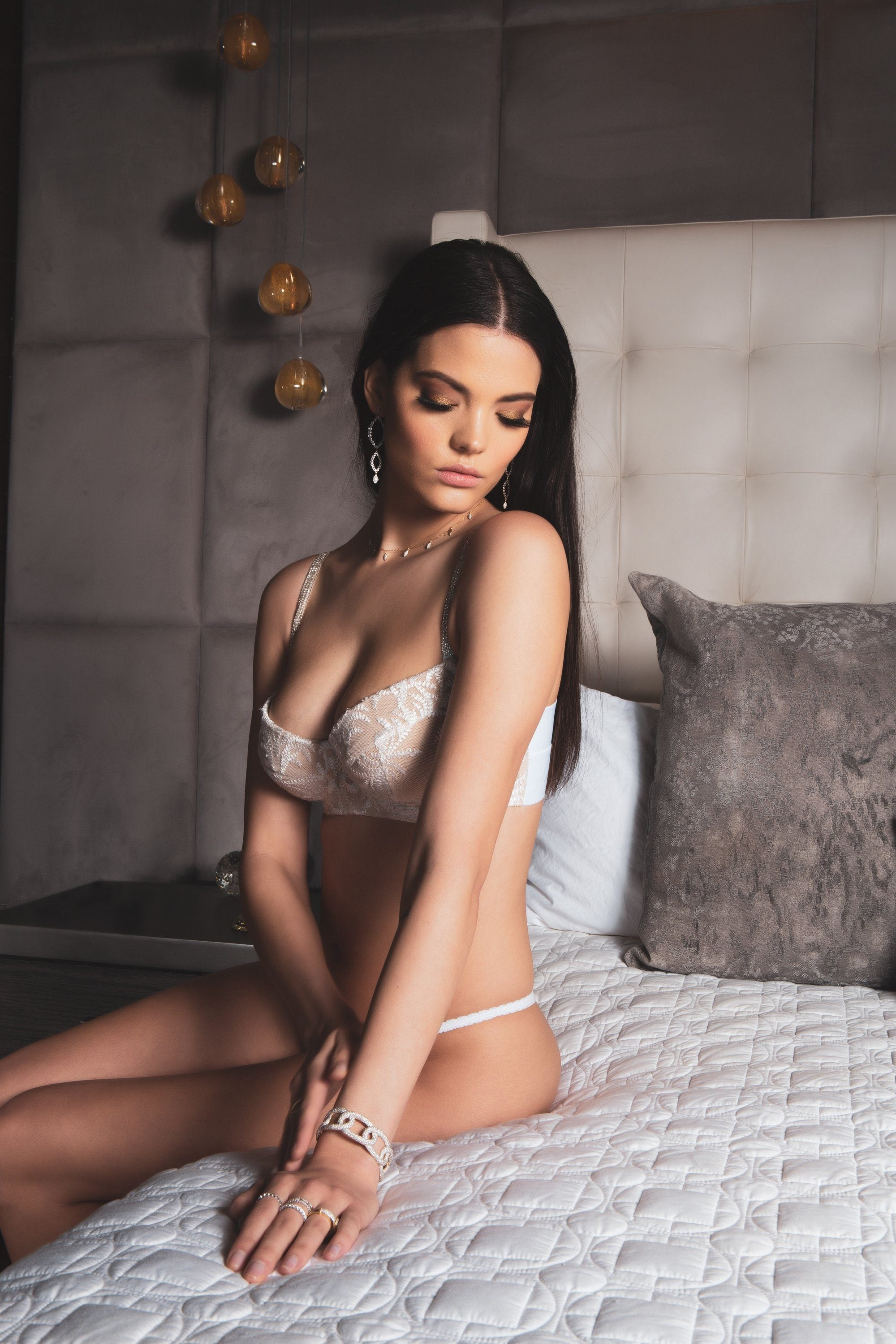 woman wearing white lace bra and panty on bed