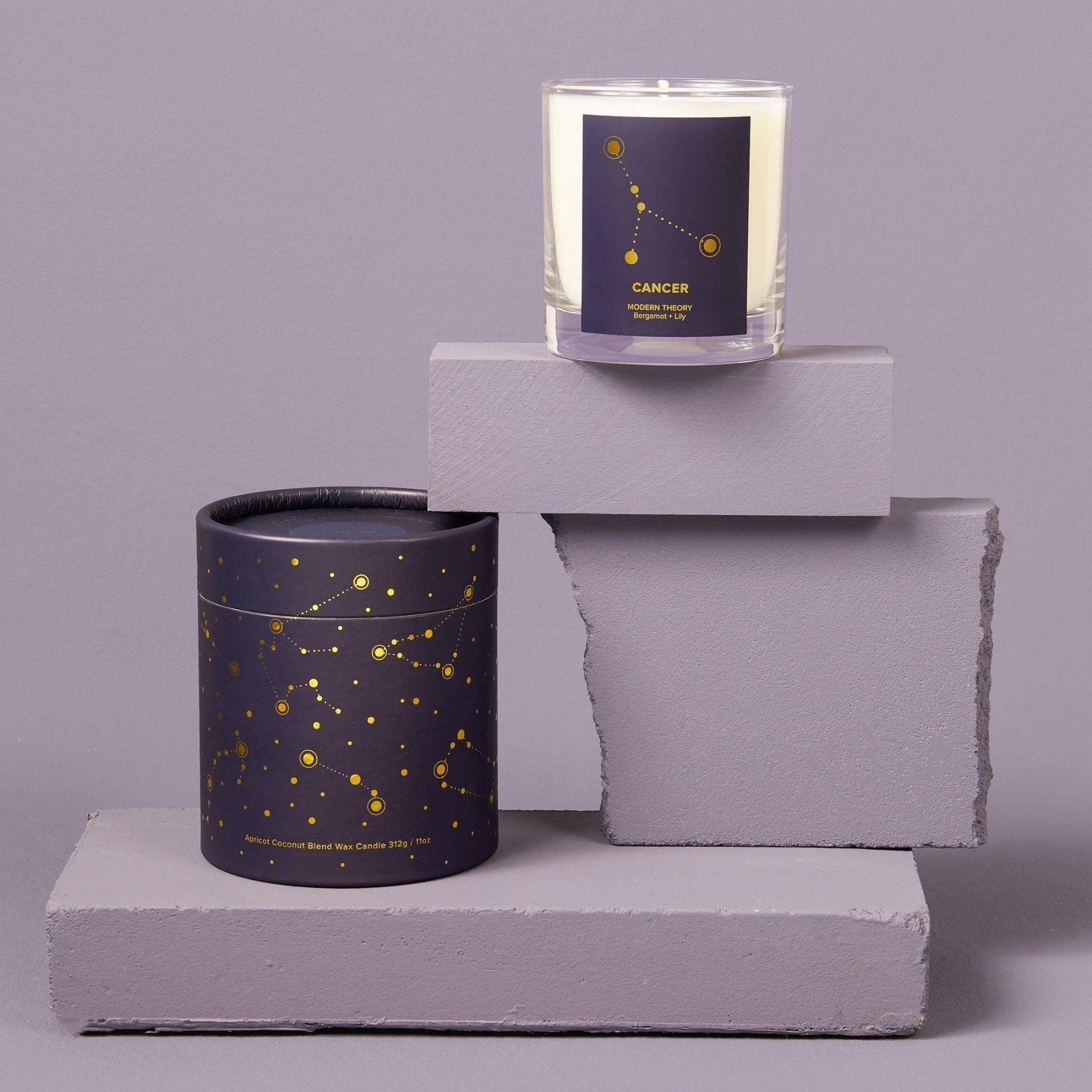 Candle in glass jar with purple and star label  with astrology sign cancer