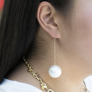oversized pearl on gold delicate chain earring