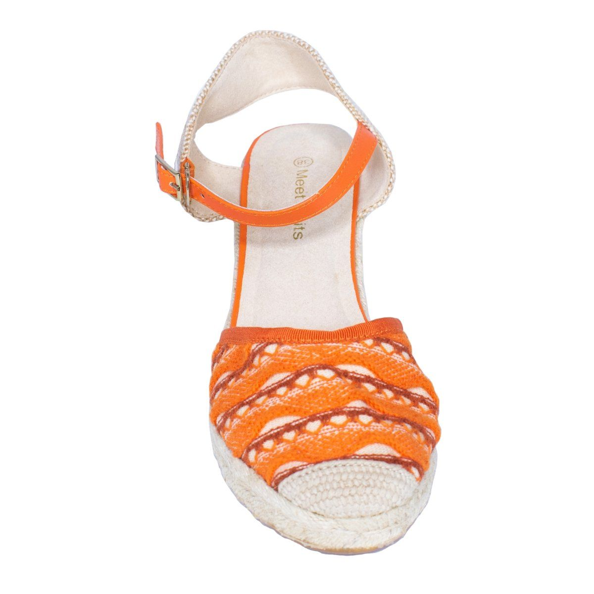 Front close view of knit wedge sandal with closed toe and orange woven pattern