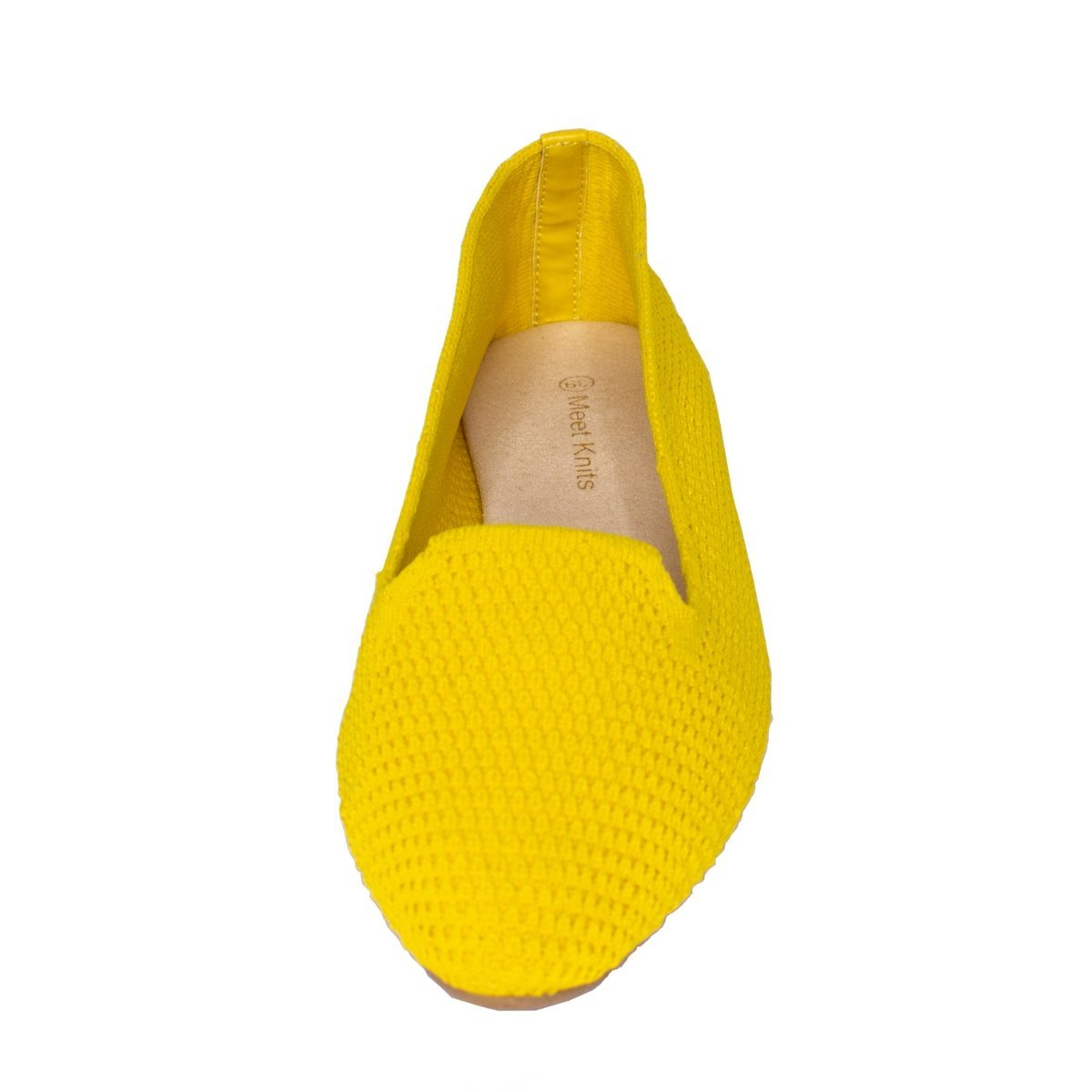Close front view of yellow knitted flat slip on shoes