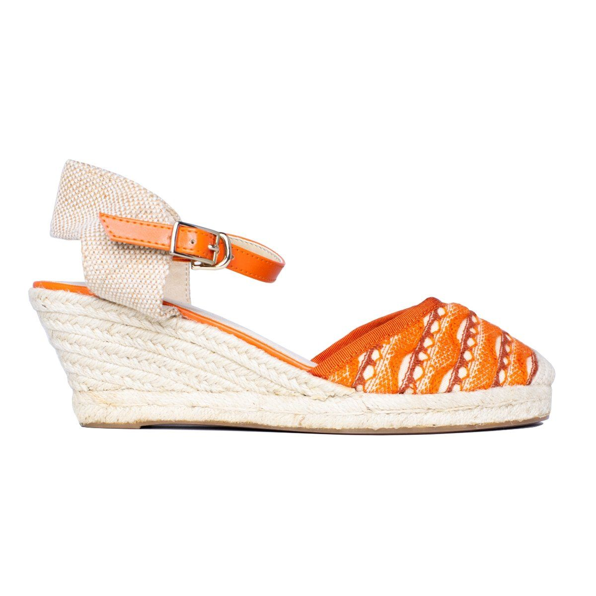 Close side view of knit wedge sandal with buckle and orange cotton pattern