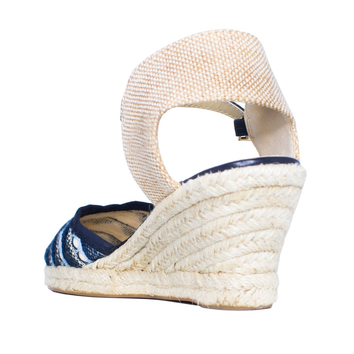 Back view of wedge sandal with heel strap and navy blue woven pattern