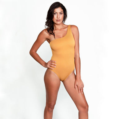 model wearing gold one shoulder one piece swimsuit