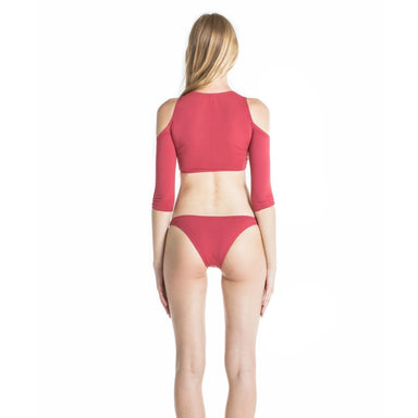 back of model wearing two piece swim suit with crop top and bikini bottom in red