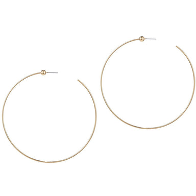 Side view photo of large gold hoop earrings with small ball near opening