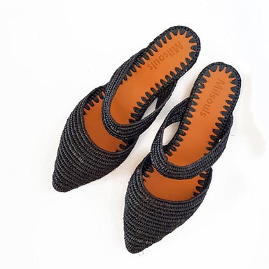 Top view photo of black pointed toe slip on flats made from raffia grass and leather