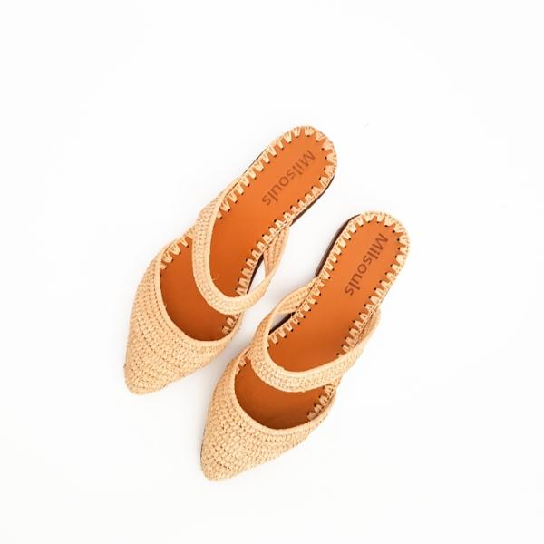 Top view of pointed toe shoes made from raffia grass and leather