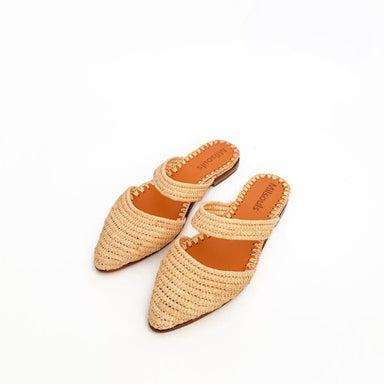 Photo of pointed toe slip on flats made from raffia grass and leather