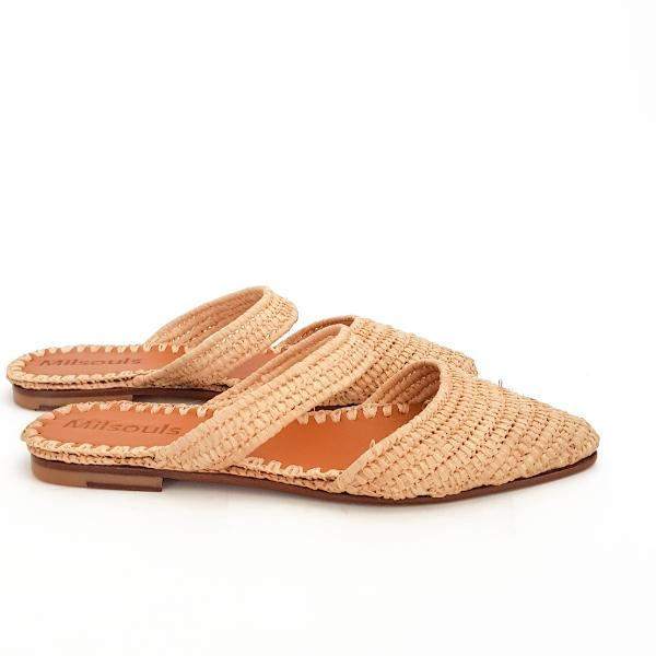 Close side view of pointed toe shoes made from raffia grass and leather
