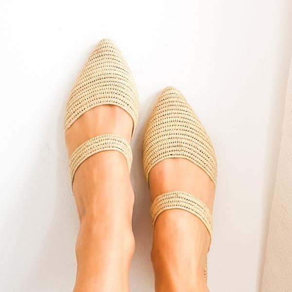 close up of feet in pointed toe shoes made from raffia grass and leather