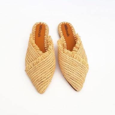 Front view of pointed toe slip on mules made from raffia grass and leather
