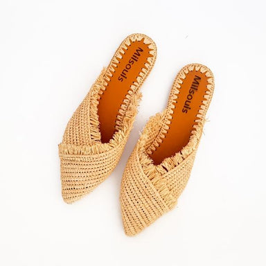 Top view of pointed toe slip on mules made from raffia grass and leather