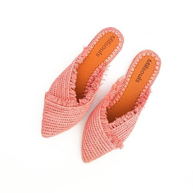 Top view photo of pink pointed toe slip on mules made from raffia grass and leather