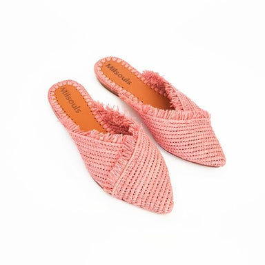 Side view of pink pointed toe slip on mules made from raffia grass and leather
