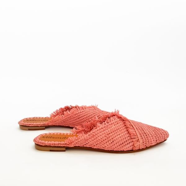 Side view photo of pink pointed toe slip on mules made from raffia grass and leather