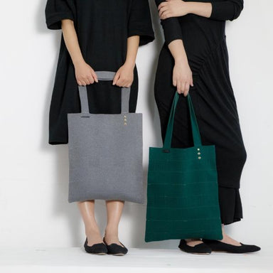 Women modeling two cotton tote bags in gray and green