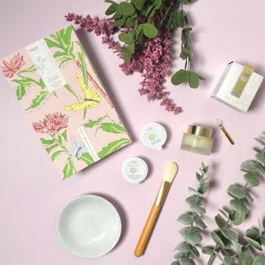 Decorative box and skincare components spread out with floral accents