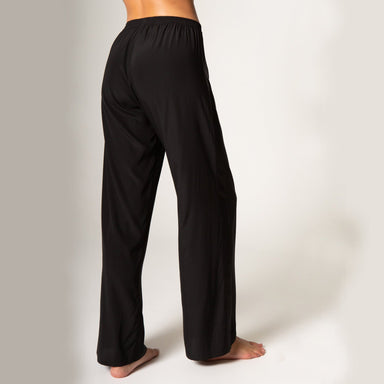 side view woman wearing black satin pants